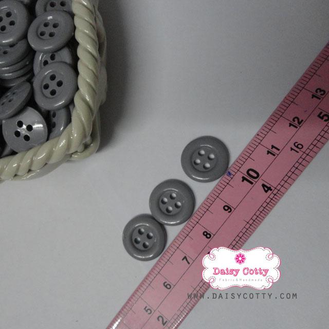 กระดุมพลาสติกสีเทา ขนาด 1.5 ซ.ม. จำนวน 12 เม็ด(1โหล)