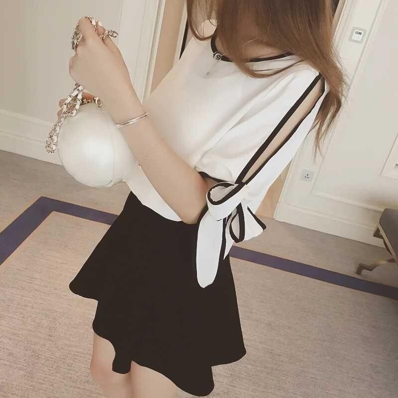 เสื้อแฟชั่นสาวๆ แขน 3 ส่วน ผ่าข้างแขนเสื้อแบบเก๋ๆ ตัดขอบด้วยสีดำ ดูสวยงามลงตัว