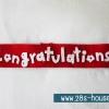 สายผ้าคาด ผ้าห่มม้วนตุ๊กตา วันรับปริญญา (Congratulations) สีแดง ## พร้อมส่งค่ะ ##