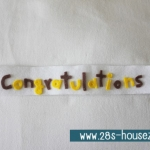 สายผ้าคาด หมอนอิงตุ๊กตา วันรับปริญญา (Congratulations) สีขาว ## พร้อมส่งค่ะ ##