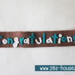สายผ้าคาด หมอนอิงตุ๊กตา วันรับปริญญา (Congratulations) สีน้ำตาล ## พร้อมส่งค่ะ ##