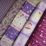 Set 5 ชิ้น : ผ้าคอตตอน 100% 4 ลาย และผ้าแคนวาสลายตารางโทนสีม่วง ชิ้นละ1/8 ม.(50x27.5ซม.)